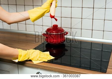 Someone Is Washing A Kitchen Stove With Cleaning Supplies. Someone Is Cleaning A Kitchen With Rag.