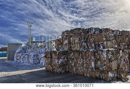 Sweden, Orebro, 24.02.2020: Paper Garbage At The Recycling Plant, Large Square Bales Of Paper. Paper