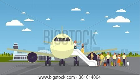 People Stand At The Plane In Airport In Queue. Board On The Airplane.