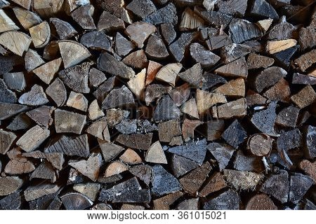 Firewood In A Woodpile, Vintage Texture. Chipped Firewood As A Background
