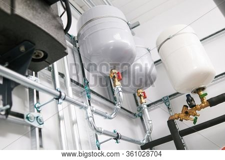 Plumbing service. stainless steel pipeline and expansion vessel of a heating system in boiler room