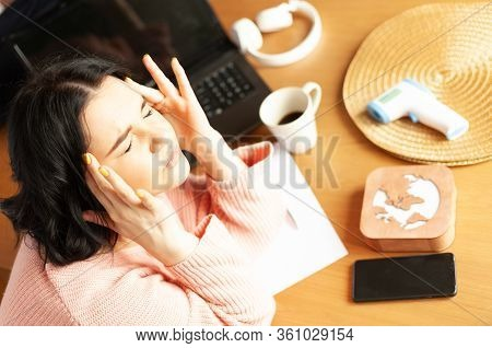 Young Woman Tired Of Work Migraine Stress