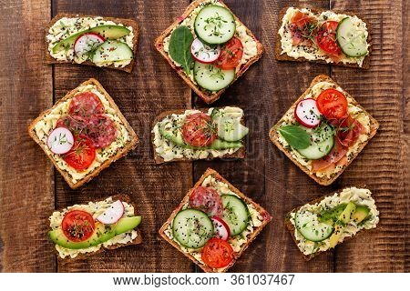 Variety Of Mini Sandwiches With Cream Cheese, Vegetables And Salami. Sandwiches With Cucumber, Radis