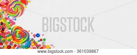 Colorful Assorted Candies. Overhead View Corner Border With A White Banner Background.