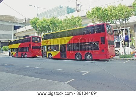 Hongkong - 18 September,2014: Colorful Double-decker Buses Are Running In The Street
