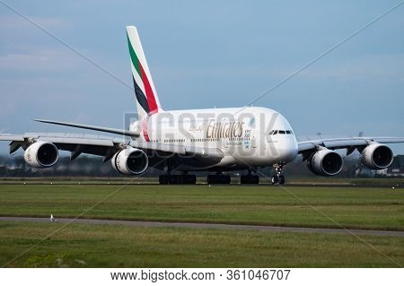 Amsterdam / Netherlands - August 13, 2014: Emirates Airlines Airbus A380 A6-edt Passenger Plane Arri