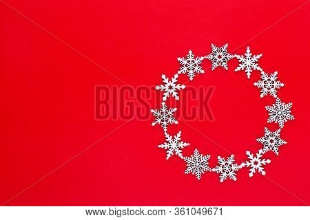 Christmas Composition. White Snow Flakes Wreath Decorations On Red Background. Christmas, Winter, Ne