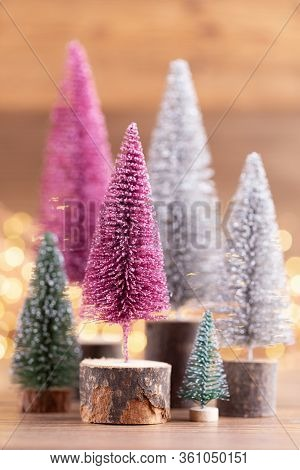 Colorful Christmas Tree On Bokeh Background. Christmas Holiday Celebration Concept. Greeting Card.