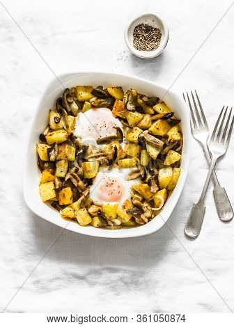 Baked Potatoes With Mushrooms And Eggs - Delicious Lunch, Breakfast, Snack On A Light Background, To