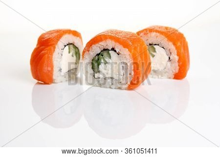 Philadelphia Sushi Roll On A White Background With Reflection.