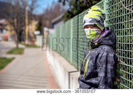 Kid With Face Mask In The Street Of City