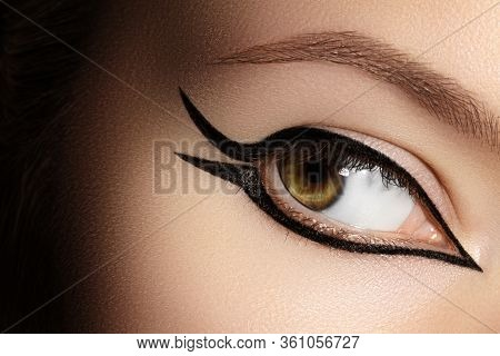 Beautiful Macro Of Female Eye With Fashion Black Eyeliner Makeup. Perfect Graphic Liner Shape. Cosme