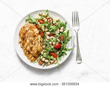 Healthy Lunch - Roasted Chicken Breast And White Beans, Arugula, Cherry Tomatoes Salad On A Light Ba