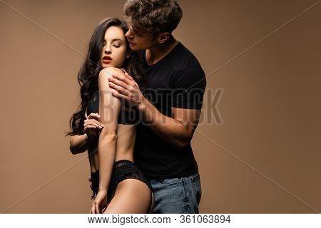 Beautiful Intimate Couple Hugging Isolated On Beige