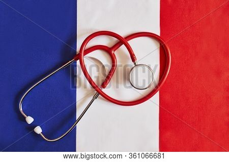 Phonendoscope Forming Heart Shape On French Flag. Outbreak Of Coronavirus Covid-19 In France. Hard W