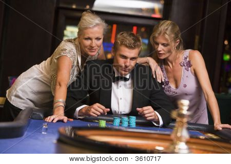 Men And Women Playing Roulette
