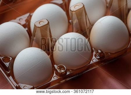 Concept Of Natural Eggs. A Tray Of Eggs On A Pink Background. Eco Tray With Testicles. Minimalistic