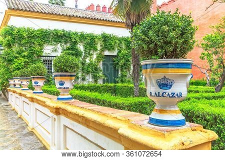 Seville, Andalusia, Spain - April 19, 2016: Ceramic Pot Vase In Hedge Maze Decorates Garden Of Royal