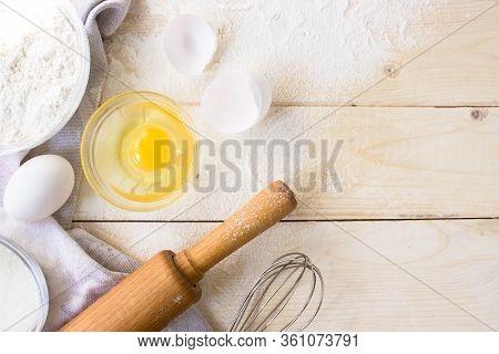 Eggs, Sugar, Flour, Whisk, Rolling Pin On Vintage Wooden Background. Cooking Dessert Flat Lay Top Vi