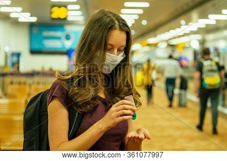 Travel Woman In Mask In Airport Flight Delay Flight Cancellation Airspace Is Closed Because Corona V