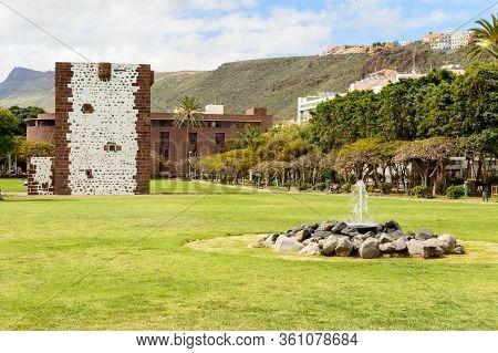 Conde Tower Behind A Picturesque Fountain 15th-century Coastal Tower In San Sebastian De La Gomera.