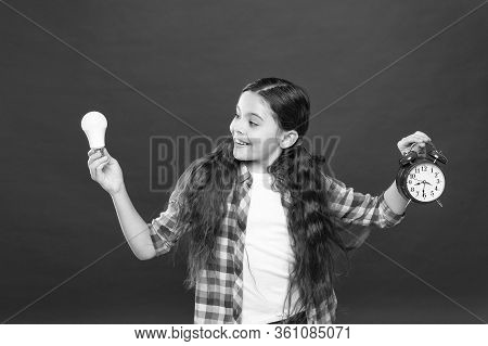 Inspired Child Hold Clock Red Background. Inspiration And Brainstorming. Electricity Energy. Little