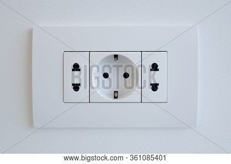 A Block Of White Outlets Consisting Of One Eu Standard Outlet With Grounding And Two Us Standard Soc