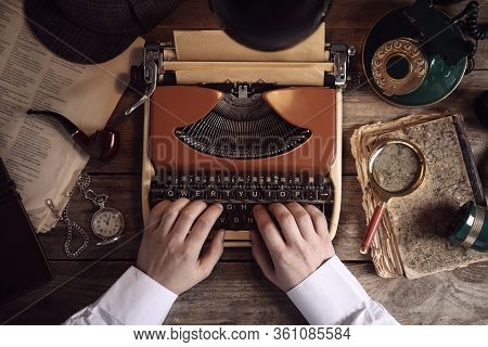 Detective Working On Vintage Typewriter At Wooden Table, Top View