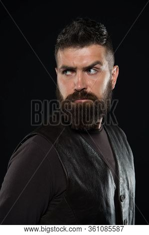 Treating Your Beard With Care. Bearded Man Dark Background. Skin And Hair Care Routine. Skincare And