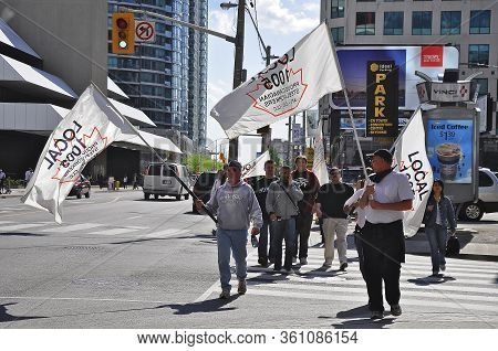 Toronto, Ontario, Canada - 05/29/2009 :  Protestors Holding Flags On The Peace Demonstration In Toro