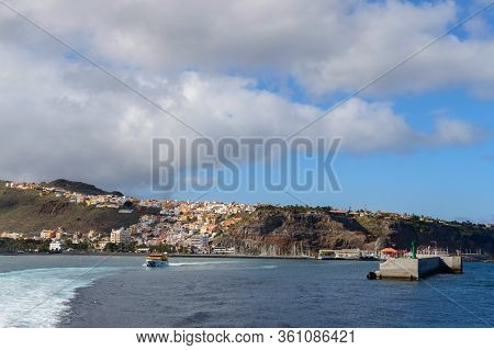 Magnificent Views From The Sea With The Wake Of The Ferry And As Background The Island Of La Gomera.