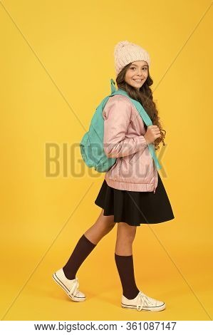 Welcome Back To School. Happy Child Back To School. Little Girl Go To School Yellow Background. Back