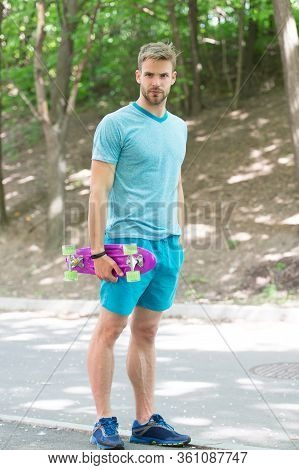 Skateboarding For Extreme Freedom And Drive. Athletic Man Hold Penny Board Outdoors. Skateboarding S