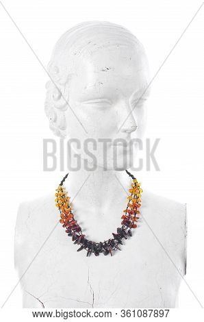 Manikin Stylish With Amber Necklace Isolated On The White Background