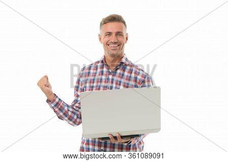 Bingo. Happy Winner Hold Laptop Isolated On White. Handsome Man Make Winners Gesture. Winner Or Cham