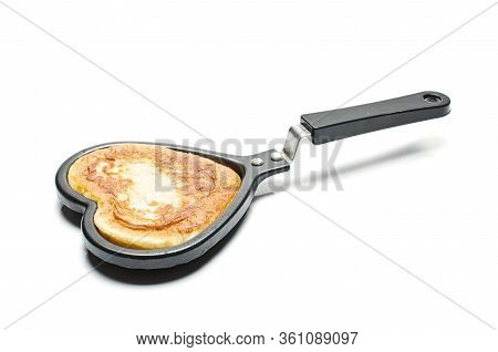 Pastry In The Heart Shape Pan Isolated
