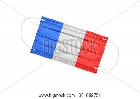 Medical Mask With France Flag Isolated On A White Background. Pandemic Concept In France. Attribute