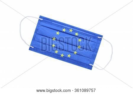 Medical Mask With Flag Of European Union Isolated On White Background. Pandemic Concept In Europe. A