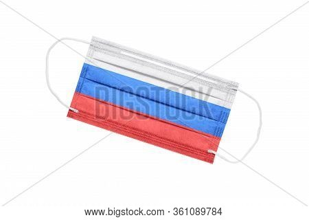 Medical Face Mask With Flag Of Russia Isolated On White Background. Pandemic Concept In Russia. Attr