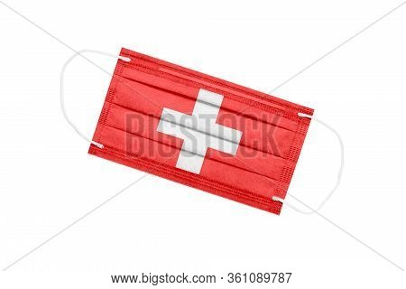 Medical Face Mask With Flag Of Switzerland Isolated On White Background. Pandemic Concept In Switzer
