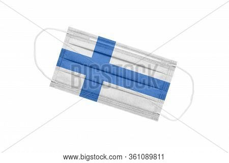 Medical Face Mask With Flag Of Finland Isolated On A White Background. Finland Pandemic Concept. Att