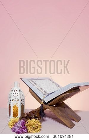 Quran Open In Wooden Placemat. Holy Month In The Muslim World - Ramadan Kareem. Eid-al-adha Concept.