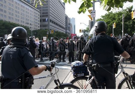 Toronto, Ontario, Canada - 06/25/2010 :  Police In Full Gear To Control Thousands Activists Marching