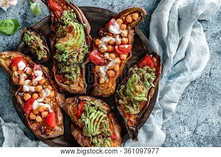 Baked Sweet Potato Toast With Roasted Chickpeas, Tomatoes, Goat Cheese, Sauce Guacamole, Avocado, Se