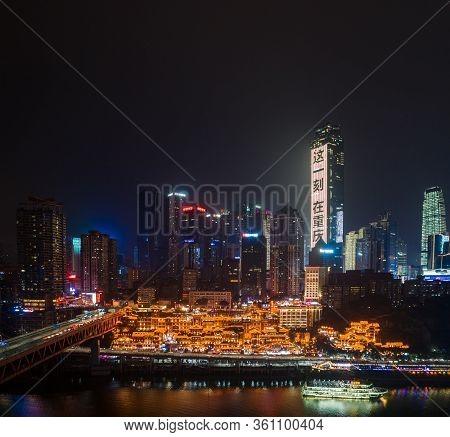Dec 22, 2019 - Chongqing, China: Aerial Night View Of Hong Ya Dong Cave By Jialing River