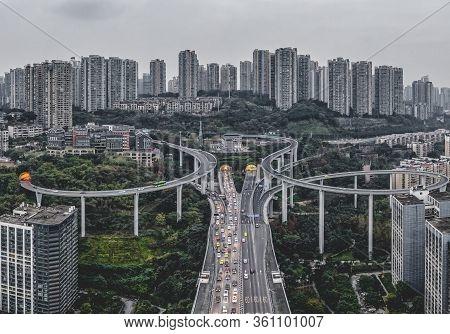 Dec 23, 2019 - Chongqing, China: Aerial Drone Shot Of Caiyuanba Flyover With Traffic In Bleak Mornin