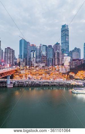 Dec 22, 2019 - Chongqing, China: Aerial Drone Shot Of Hong Ya Dong Cave By Jialing River