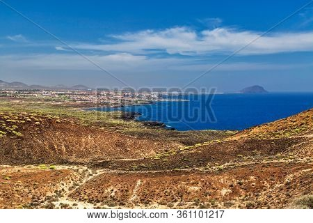 View of the mountains and sea under blue sky in Tenerife, Canary Islands, Spain