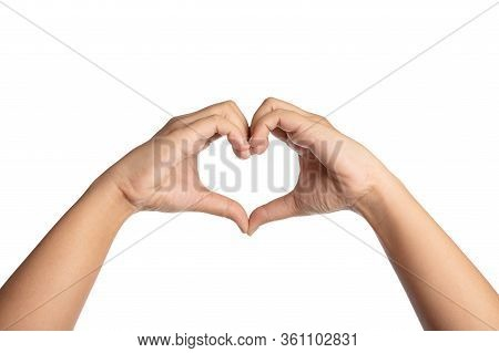 Close Up The Hand Of The Woman Making A Heart From Two Hands. Open The Palm Of The Hand Isolated On