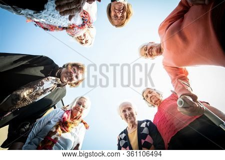 Mature people in circle with hands for unity and friendship